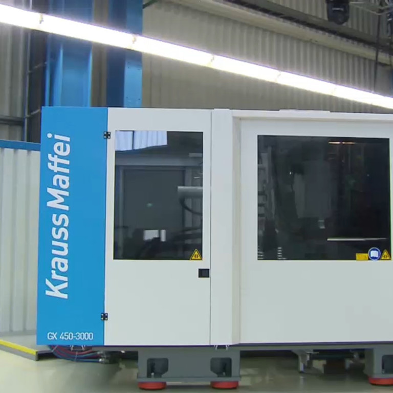 INJECTION MOLDING MACHINERY